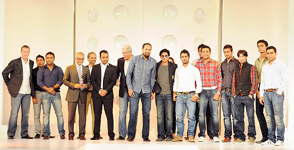 Team owner Shah Rukh Khan with KKR team and management