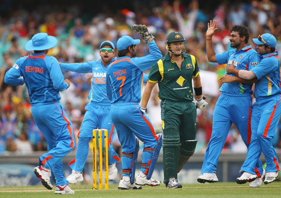 Praveen Kumar of India is congratulated by team mates after dismissing Shane Watson of Australia during the One Day International