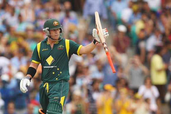 David Warner of Australia reacts after scoring fifty runs during the One Day International match between Australia and India at the Sydney Cricket Ground