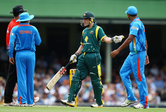 David Hussey of Australia speaks with Umpire Simon Taufel after his run out interference appeal was given not out during the One Day International