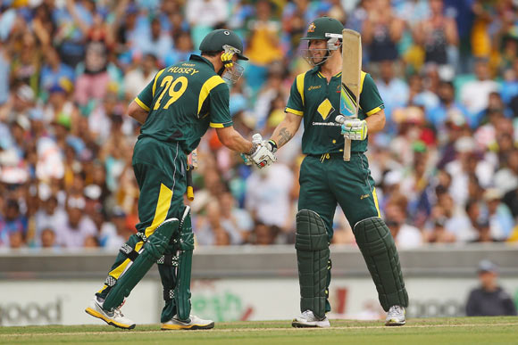 Matthew Wade of Australia is congratulated by team mate David Hussey after scoring fifty runs during the One Day International match