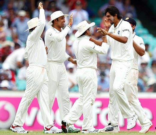 Ishant Sharma (right) celebrates with team-mates after taking the wicket of Ricky Ponting