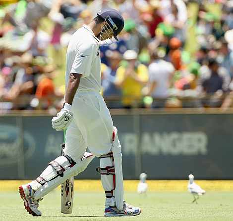 Rahul Dravid walks back to the pavilion after being dismissed
