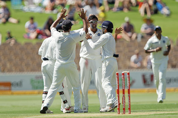 Ravichandran Ashwin (C) celebrates with team mates after getting the wicket of Shaun Marsh