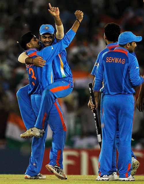 The Indian team celebrate victory over Pakistan during the World Cup semi-final