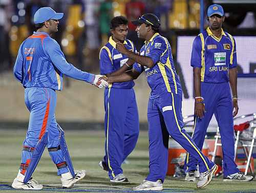 India's captain MS Dhoni shakes hands with Sri Lanka's captain Mahela Jayawardene after the second one-day in Hambantota