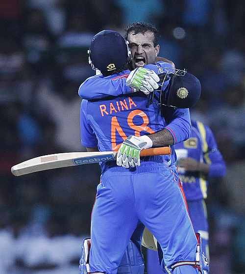 India's Irfan Pathan and Suresh Raina celebrate after winning the third One-Day match against Sri Lanka