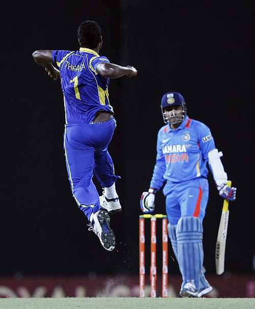 Thisara Perera celebrates after picking the wicket of Virender Sehwag