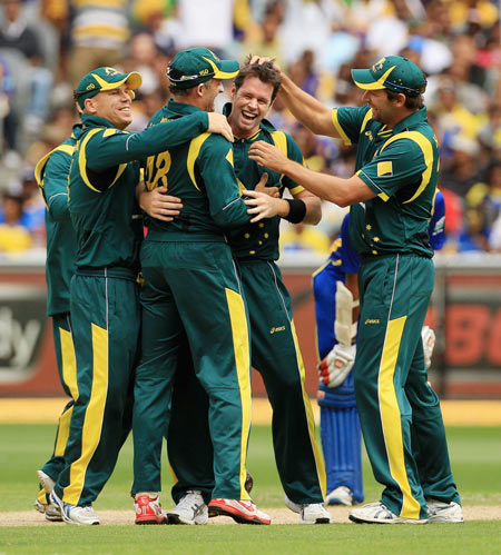 Daniel Christian (C) celebrates with team mates after dismissing Nuwan Kulasekara to complete a hat-trick