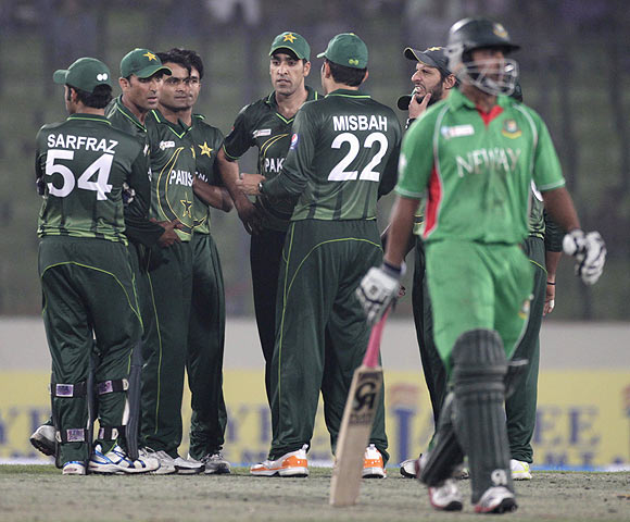 Bangladesh Tamim Iqbal (right) leaves the field as Pakistan's fielders celebrate