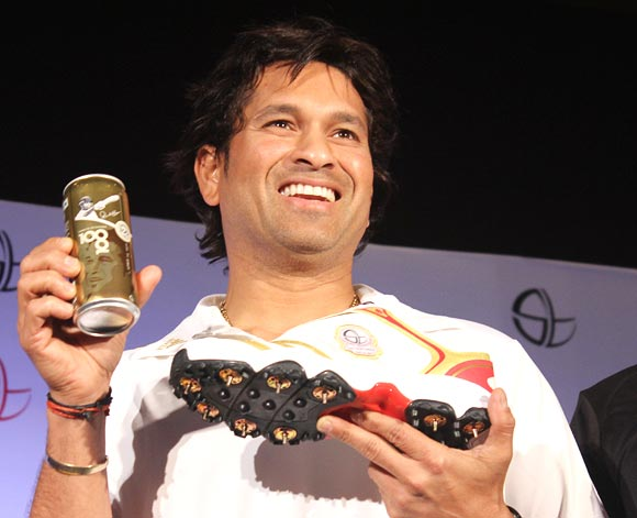 Sachin Tendulkar with the limited edition Coca-Cola Golden Can and the golden shoe launched by Adidas to celebrate his 100th century in international cricket