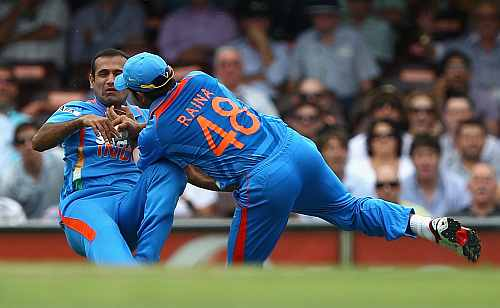 Irfan Pathan and Suresh Raina misjudge a catch