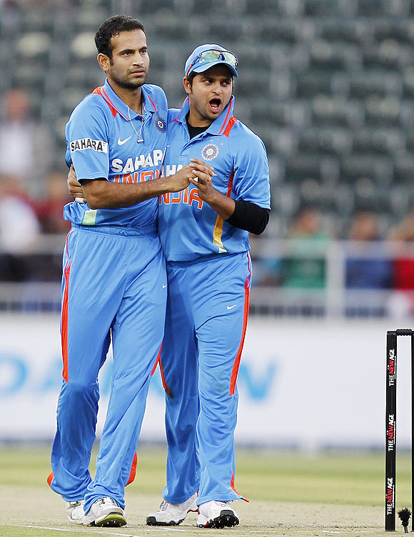 Irfan Pathan (left) celebrates with teammate Suresh Raina (right) after the dismissal of Richard Levi