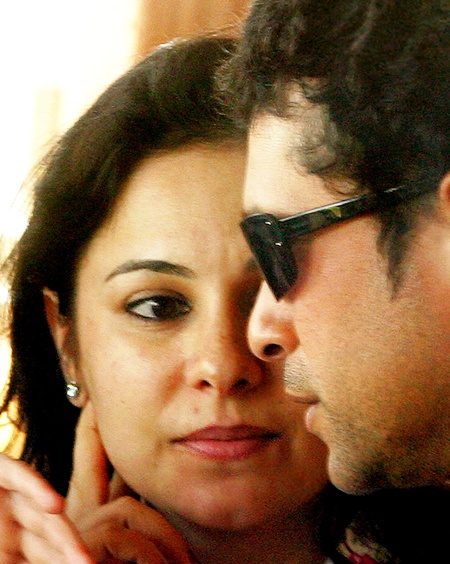 India's cricket player Sachin Tendulkar (right) shares a moment with his wife