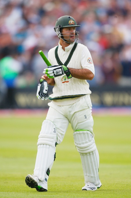 Australia captain Ricky Ponting walks off after being bowled by Graeme Swann