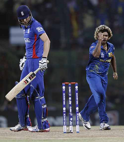 Sri Lanka's Lasith Malinga celebrates taking wicket of England's Alex Hales during their Twenty20 World Cup Super 8 cricket match in Pallekele