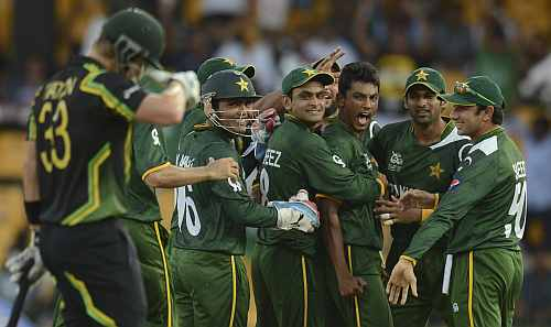 Pakistan's Raza Hasan celebrates with teammates after dismissing Australia's Shane Watson during the ICC World Twenty20 Super 8 match