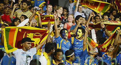 Sri Lankan fans celebrate after their team defeated Pakistan on Thursday