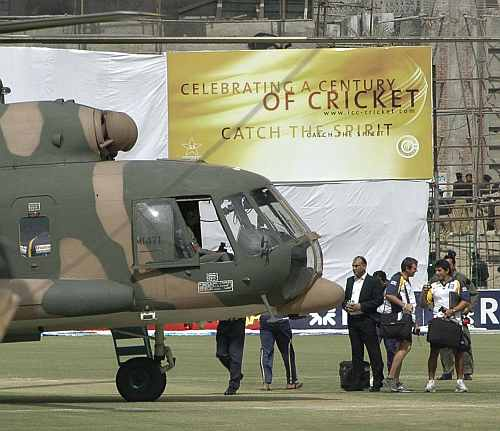 Sri Lankan cricket team members prepare to board a Pakistani military helicopter after a shooting in Lahore
