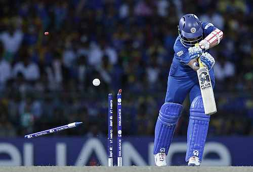 Sri Lanka's Tillakaratne Dilshan is bowled out by West Indies' Ravi Rampaul during their World Twenty20 final cricket match in Colombo