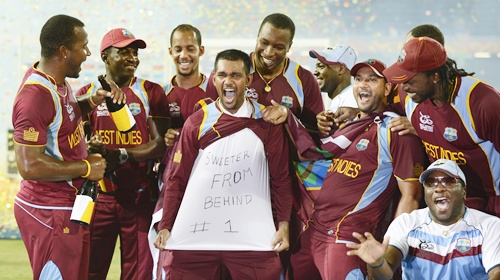 West Indies' Denesh Ramden shows off some writing on a shirt after winnin