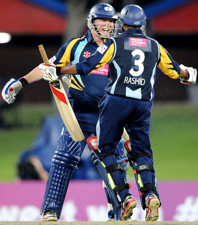 Gary Ballance and Adil Rashid of Yorkshire celebrate the win during the Karbonn Smart CLT20 pre-tournament Qualifying Stage match against Trinidad and Tobago