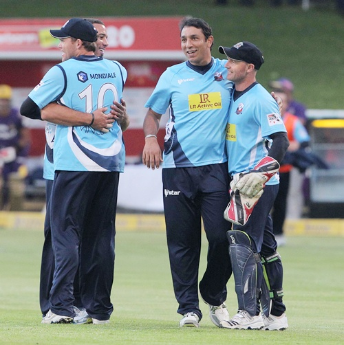 Auckland Aces teammates celebrate with Azhar Mahmood (second from right)