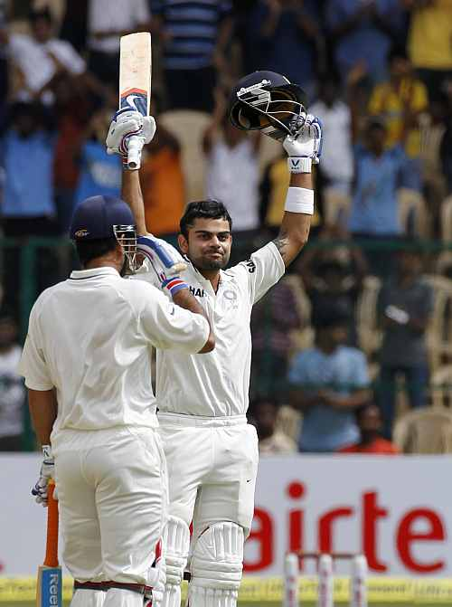 India's Virat Kohli celebrates scoring a century during their second Test match against New Zealand in Bangalore