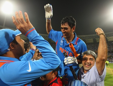 Dhoni is chaired by teammates after India win the 50 overs World Cup in 2011