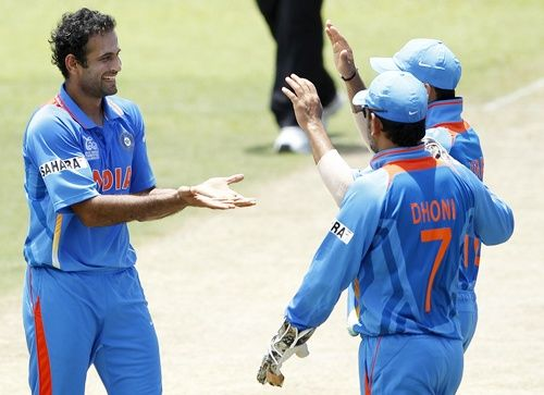 Irfan Pathan and Mahendra Singh Dhoni celebrate a wicket. Photograph: Dinuka Liyanawatte/Reuters