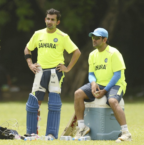 Gautam Gambhir and captain Mahendra Singh Dhoni (right) look on at a  training session