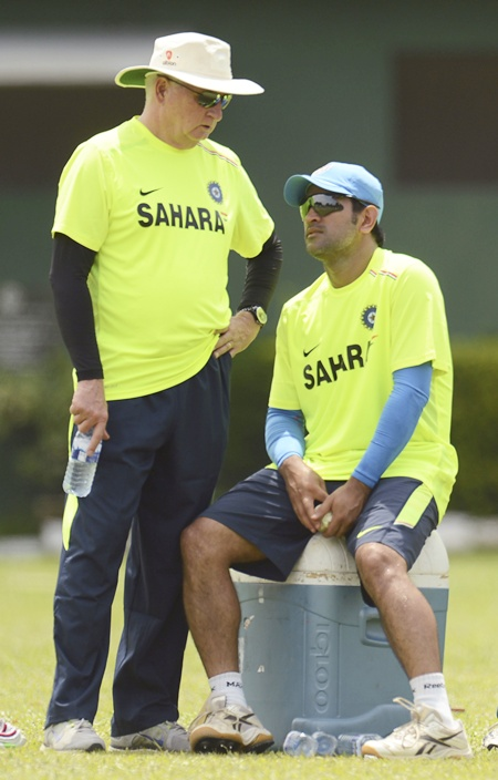 India's coach Duncan Fletcher speaks with captain Mahendra Singh Dhoni at a training   session