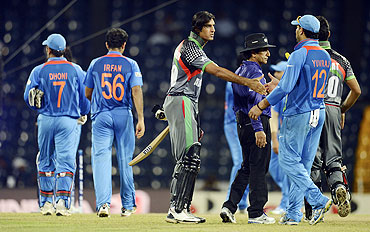 Afghanistan's Shapoor Zadran (centre) greets India's Yuvraj Singh after their losing their match on Wednesday