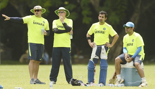 India's coach Duncan Fletcher (second left) stands with bowling coach Joe Dawes   (left) as Gautam Gambhir and captain Mahendra Singh Dhoni (right) look on at a training session