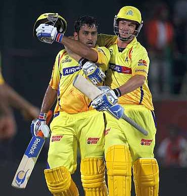 Mahendra Singh Dhoni (left) with Albie Morkel