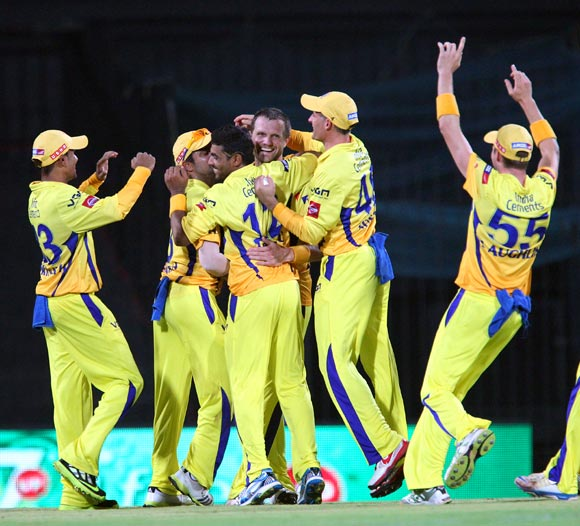 Dirk Nannes celebrates with team mates after taking the wicket of Sachin Tendulkar