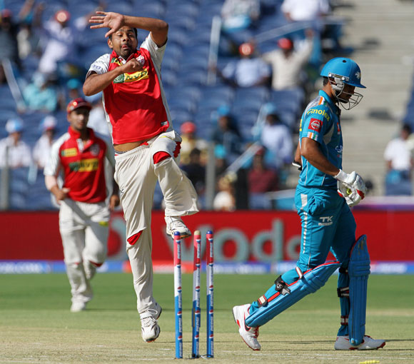 Kings XI Punjab player Praveen Kumar celebrates after getting the wicket of Pune Warriors player Manish Pandey