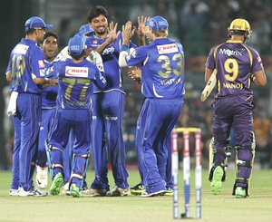 Trivedi is congratulated by teammates