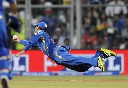 Rickey Ponting dives to his right to catch Unmukt Chand