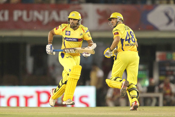 Murali Vijay of Chennai Super Kings and Michael Hussey of Chennai Super Kings cross while taking a quick single