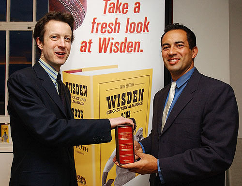 Tim De Lisle (left) editor of the 140th edition of the Wisden Cricketers' Almanac presents England Cricketer Adam Hollioake with a special copy of the Almanac to mark his award as one of five cricketers of the year, at the Launch of the Wisden Cricketers' Almanac on April 29, 2003. It was for the first time in its history that the book had used a photograph on its front cover
