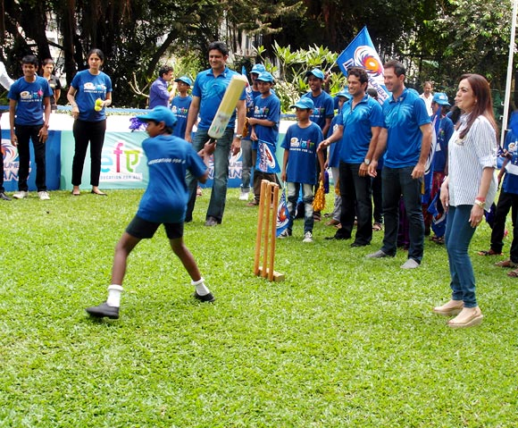 Mumbai Indians' Anil Kumble, Sachin Tendulkar and Ricky Ponting with team owner Nita Ambani at the 'Education for All' programme in Mumbai on Thursday
