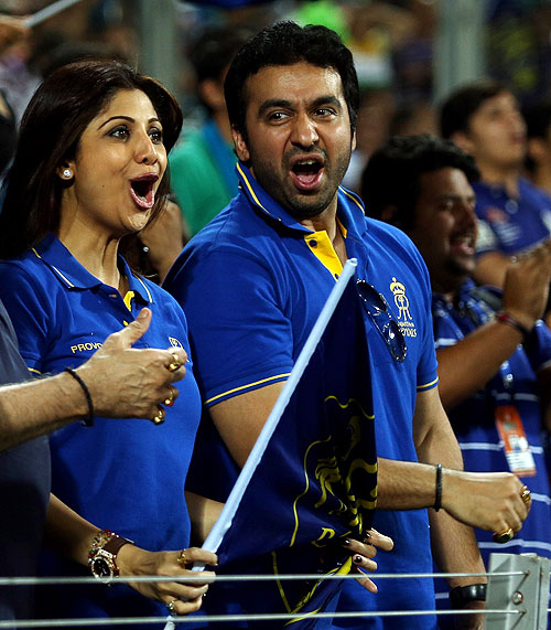Shilpa Shetty and Raj Kundra joyous after the fall of a wicket during a match between Pune Warriors India and the Rajasthan Royals on Thursday