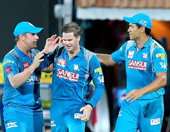 Steven Smith (centre) is congratulated by team mates Aaron Finch and Ross Taylor after taking the catch of Mahendra Singh Dhoni