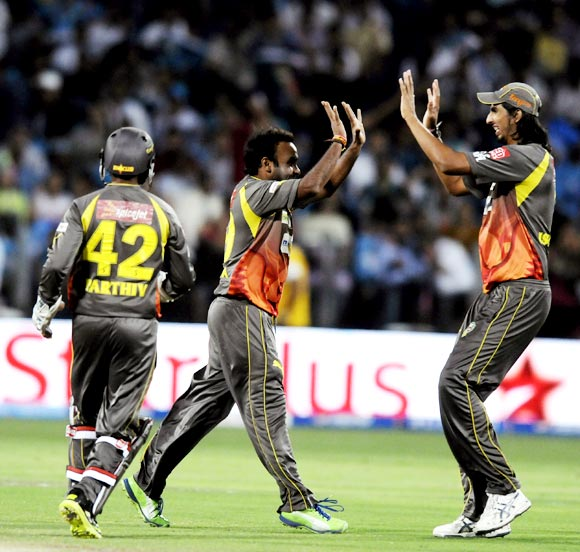 Amit Mishra is congratulated after taking the wicket of Bhuvneshwar Kumar