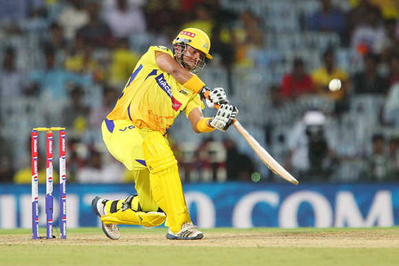Suresh Raina launches a Shane Watson delivery into the stands for six