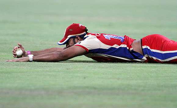 Royal Challengers Bangalore's Ravi Rampaul takes a catch to dismiss Kieron Pollard