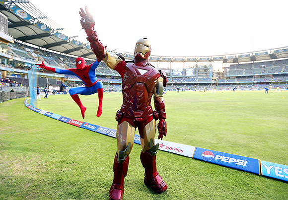 Fans dressed as Spider-Man and Iron Man entertain the fans at Wankhede Stadium on Saturday