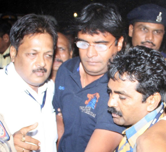 Gurunath Meiyappan (centre) with police officials