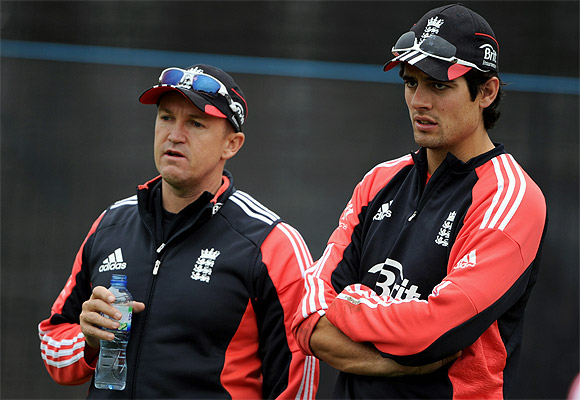 England captain Alastair Cook looks on with coach Andy Flower during a nets session